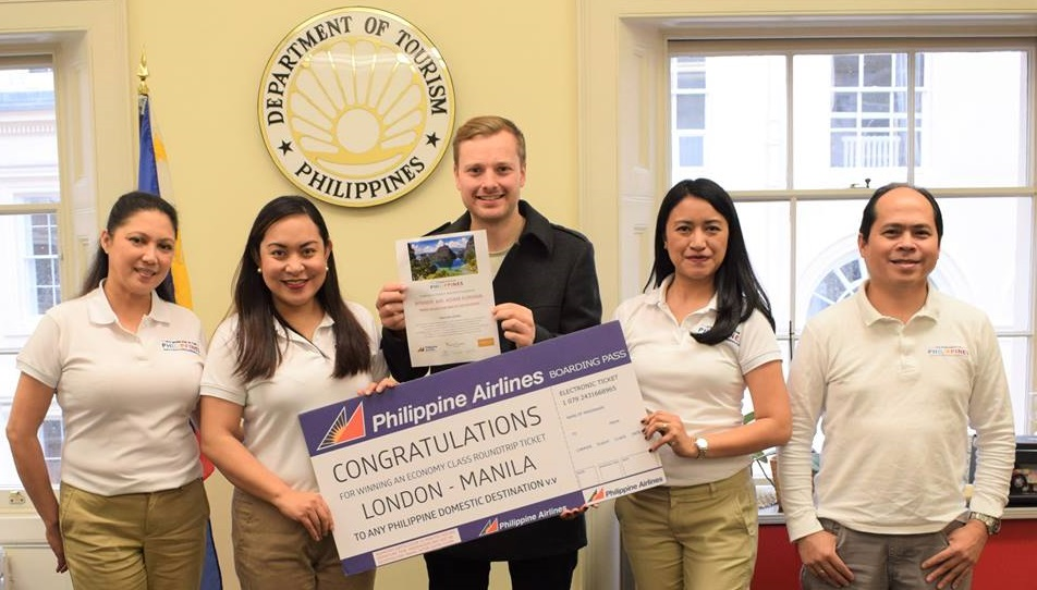 Adam Forman accepts his prize, winning a 7 night holiday in The Philippines